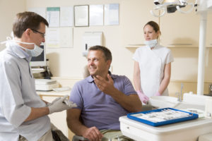 Man talking to dentist about dental implants