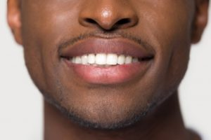 Closeup of smiling man with great oral health and immune system